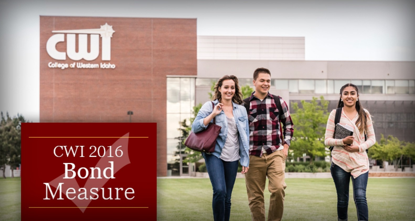 Students walking across the west lawn at Nampa Campus.