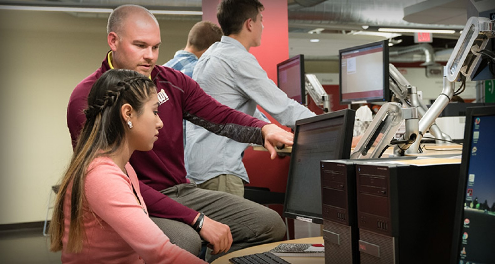Advisor helping student register for classes.