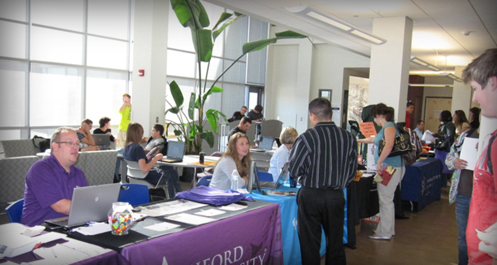 College and University booths set up at Nampa Campus Academic Buildling for Transfer Fair