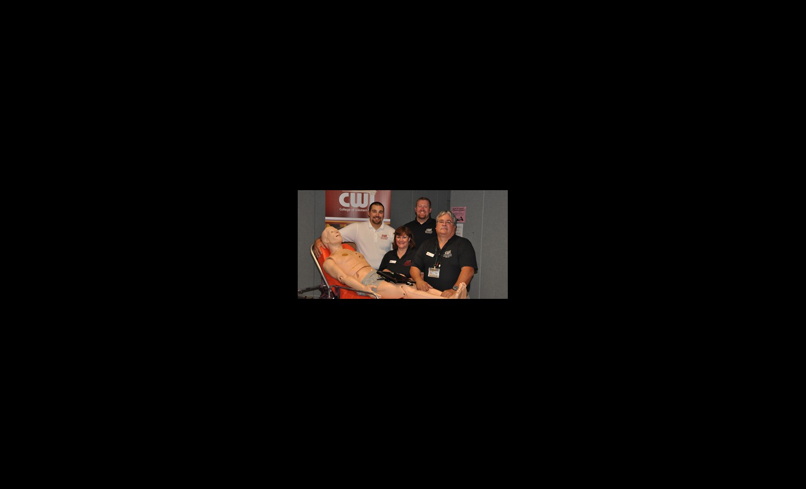 Title - Members of the CWI Paramedic program pose with a simulation manikin that was purchased through a grant.