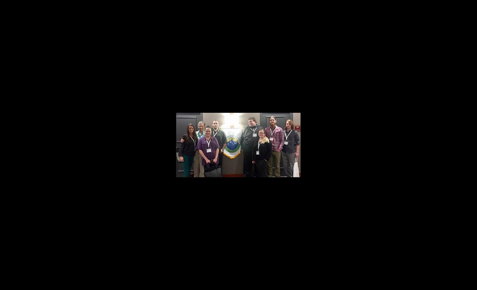 Title - (Left to right) Heather Schoenherr (Co-Advisor), Martha Timberlake (Co-Advisor), Amy Behner, Matt Hiller (Vice President), Casey Bosse (Secretary), Heather Augustine (President), David Dunn, and Ryan Greenberg (Treasurer).